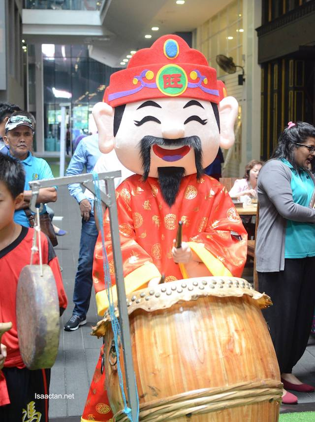 Ever seen the God of Prosperity playing the drums? Now you have.