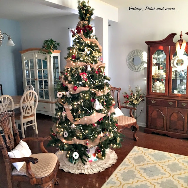 christmas decor in the living and dining rooms featuring a christmas tree