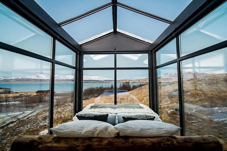 Cabin With Glass Walls In Iceland Lets Visitors Gaze At The Northern Lights While Laying In Their Bed