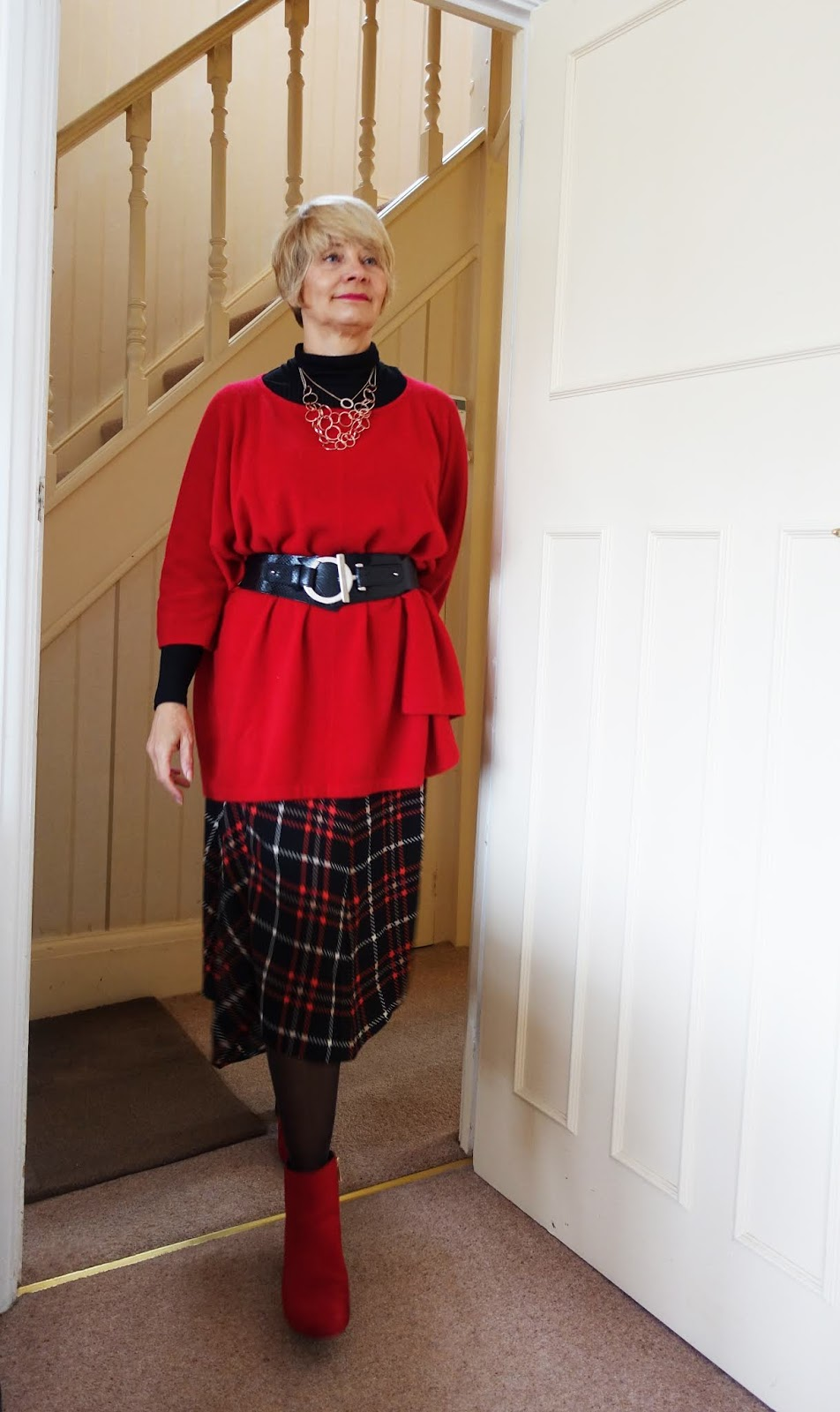 Red cashere poncho with sleeves by Denner Cashmere London, worn by Is This Mutton's Gail Hanlon