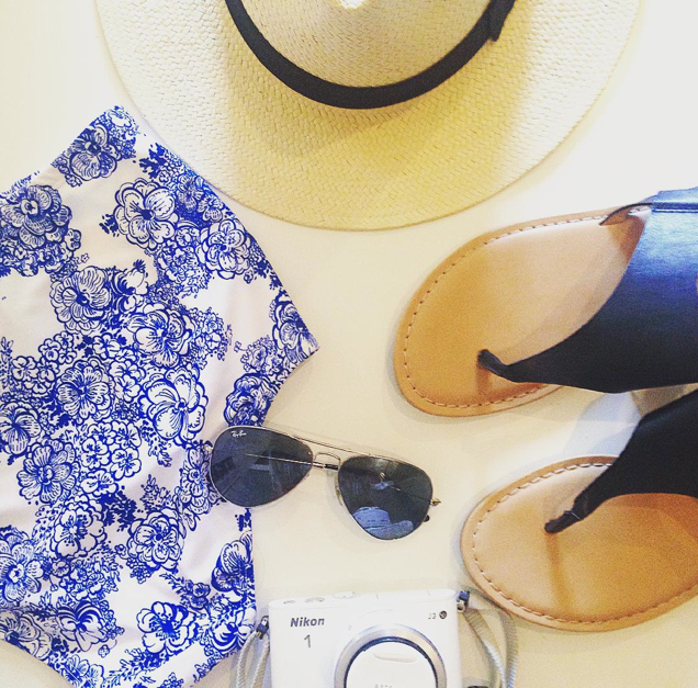 Blue and white american apparel swimsuit, old navy sandals, panama hat, ray ban aviators, nikon 1 camera