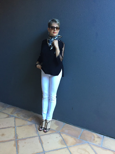 white denims, black blouse, stiletto shoes, vintage scarf