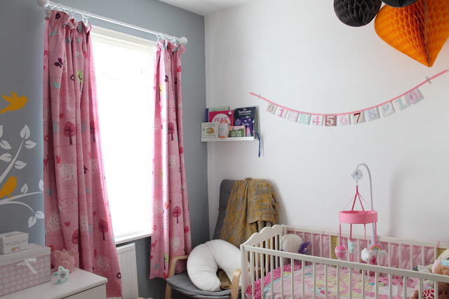 grey pink yellow and white nursery