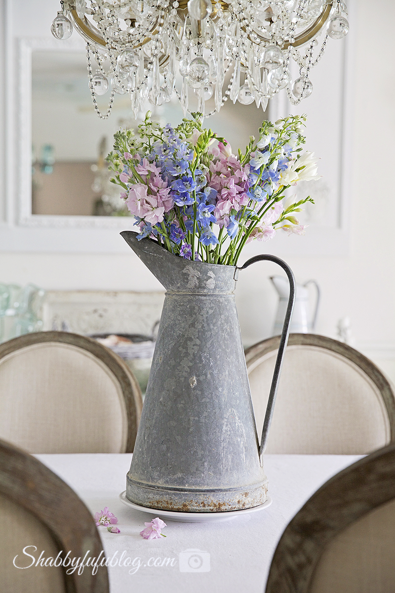 french zinc pitcher with flowers