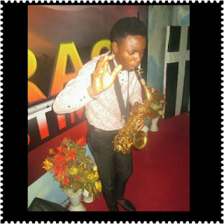 Nigerian boy playing the saxophone