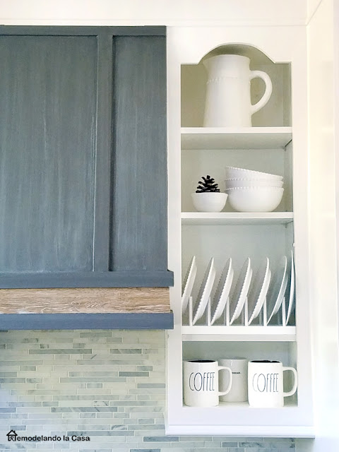 open kitchen cabinets with range hood