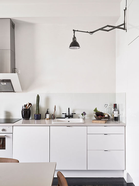 Swing arm lamps in the kitchen | Jonas Berg