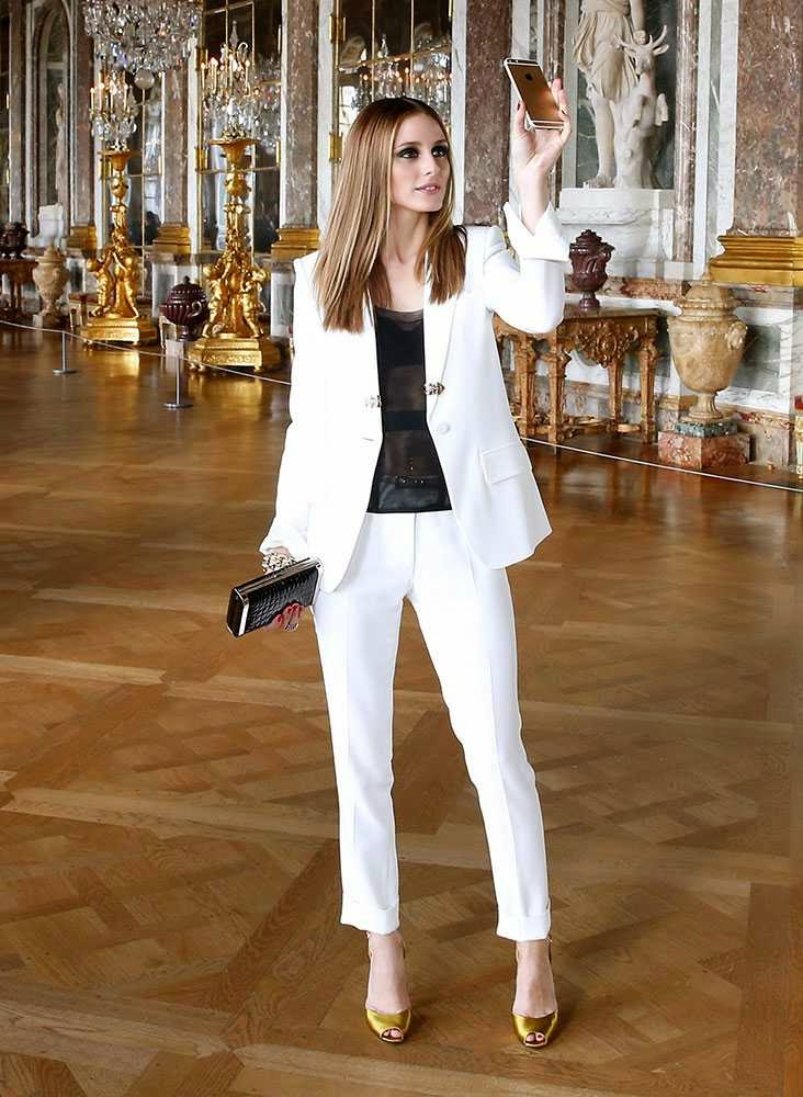 Olivia Palermo takes a selfie in the Palace of Versailles.