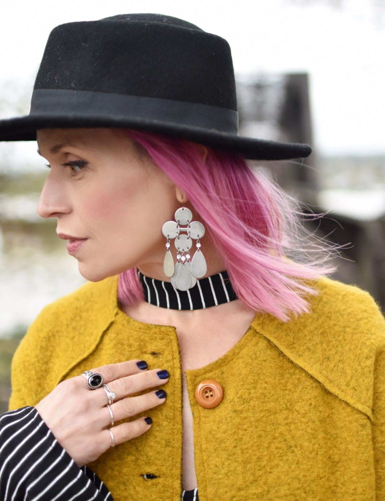 Monika Faulkner outfit inspiration - mustard wool jacket, flat-top felt fedora, fuchsia hair