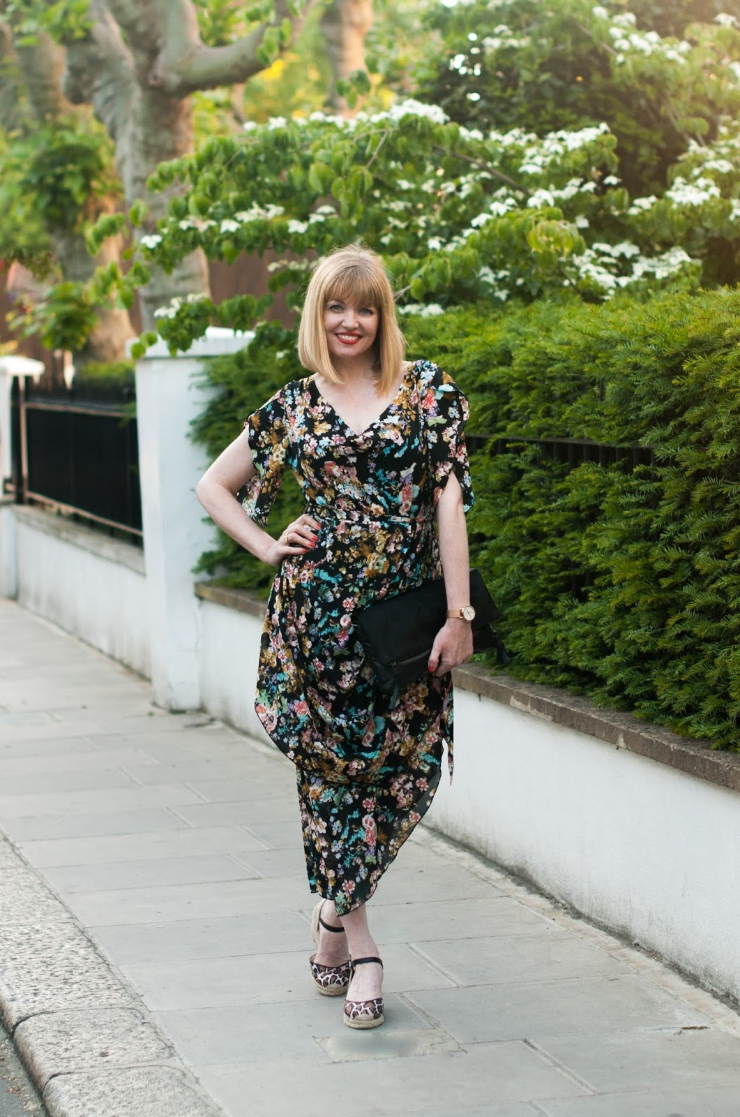 Floral draped vintage style dress with leopard print espadrilles, black clutch over 40 style