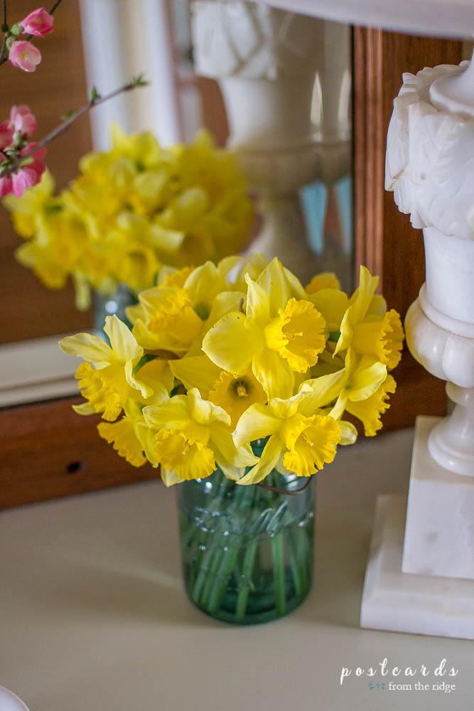 yellow daffodils in a blue mason jar for spring