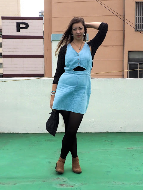 Year Round - outfit of denim cut out dress, with long grey cardigan, black tights and brown suede ankle boots
