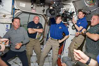Vittori, left, with some of his fellow crew members after the Endeavour arrived at the International Space Station