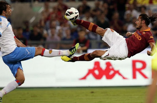 AS Roma striker Pablo Osvaldo shoots to score with a sensational scissor-kick against Catania
