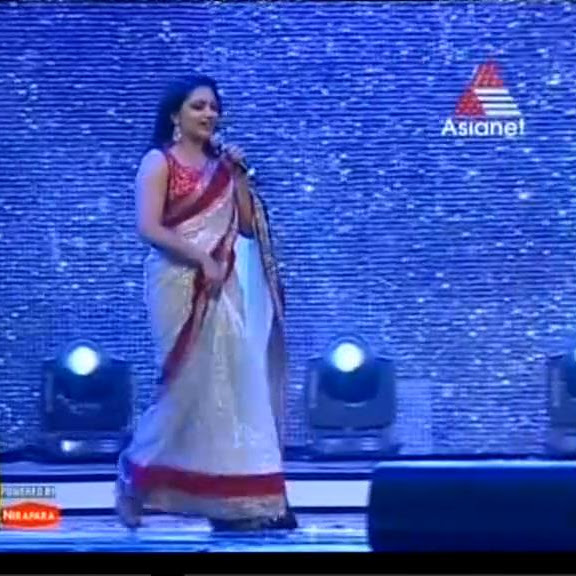 Rimi Tomy latest hot  performance in saree from Asianet Film Awards