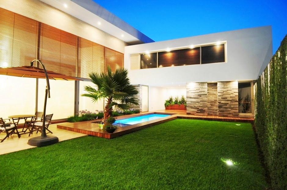 Usimak fachada de casas modernas com muros e port es for Fachadas de casas modernas 1 pavimento