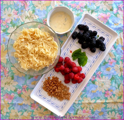 Summer Orzo Salad, a light and refreshing side dish highlighting the flavors of the fresh berries of the season. Perfect for the family or for large barbecues. | Recipe developed by www.BakingInATornado.com | #recipe #berries