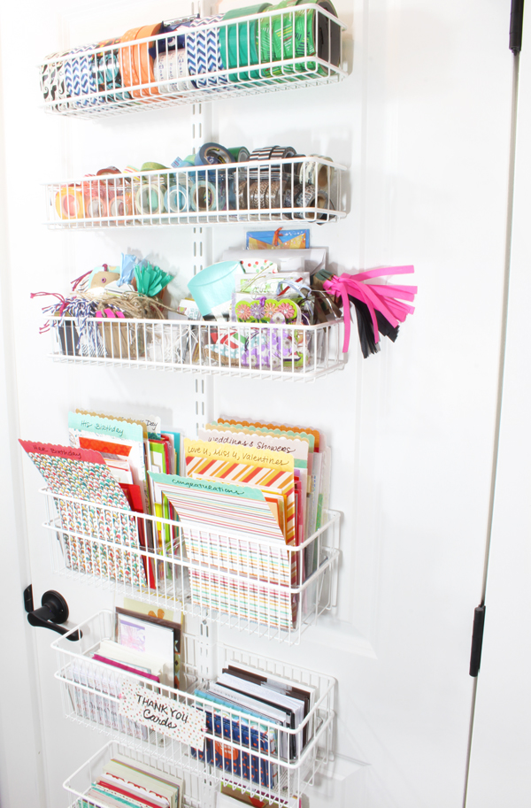 Organize gift wrap and stationery on the back of a closet door