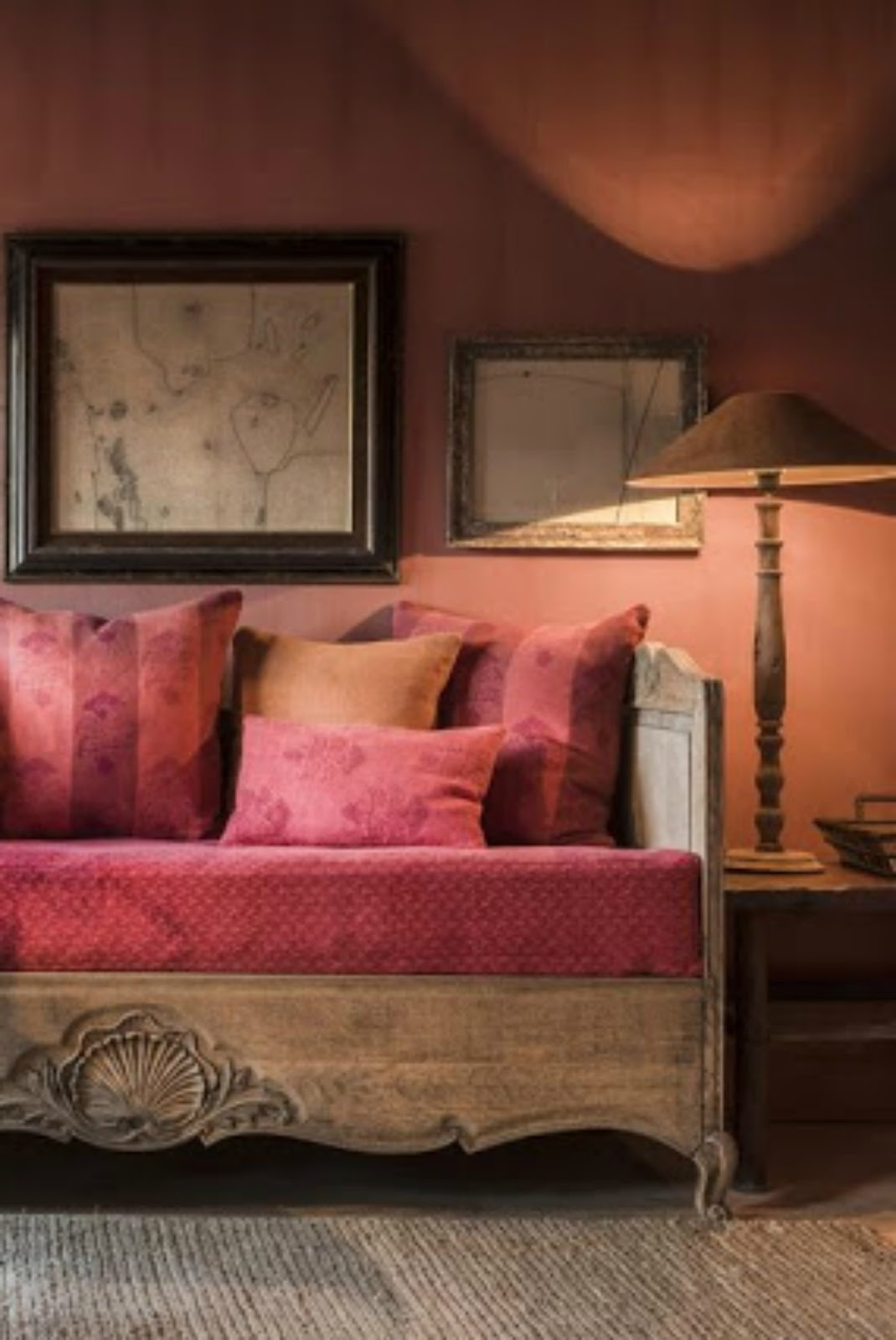 Rich red and orange interior design in a Belgian style living room - found on Hello Lovely Studio