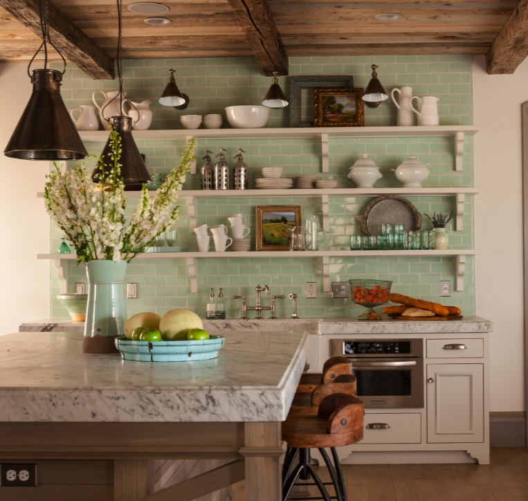 French Nordic kitchen with open shelving and green subway tile. Come see this Rustic Elegant French Gustavian Cottage by Decor de Provence in Utah! #frenchcountry #frenchfarmhouse #interiordesigninspiration #rusticdecor #europeanfarmhouse #housetour