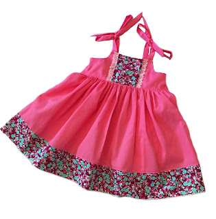 http://www.knot-dresses.com/dresses-and-tops/girls-hot-pink-ella-dress-shoulder-ties-with-floral-trim-and-elastic-back-bodice/