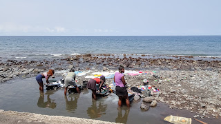 Washing clothes. A womens job in Sao Tome