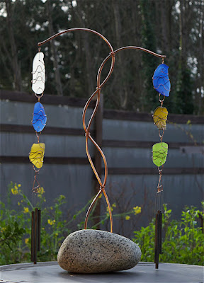 Freestanding wind chime with a natural Pacific beach stone base, glass, copper