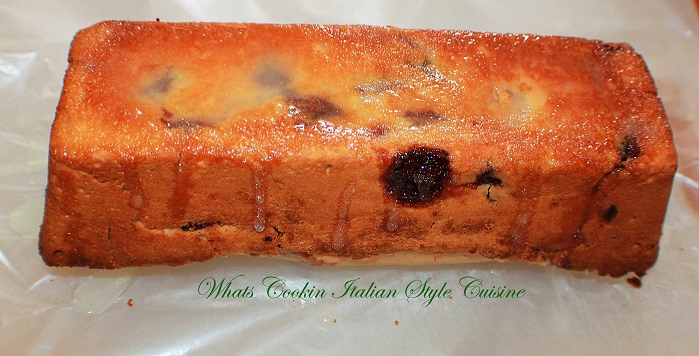 this is a delicious tender moist quick bread made with bing cherries and baked in a loaf shaped pan. It is cut open to show all the dark bing cherries inside. This is a sweet cake like quick bread