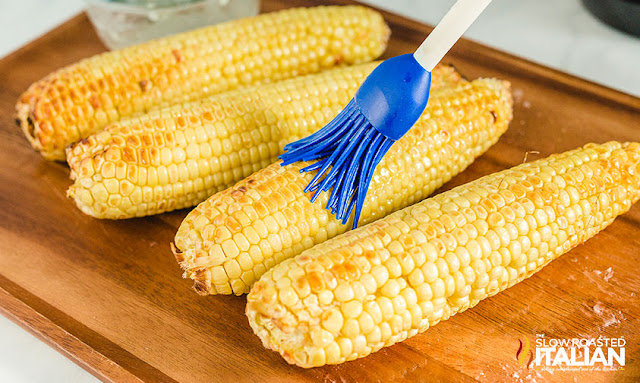 air fryer corn on the cob brushing with butter