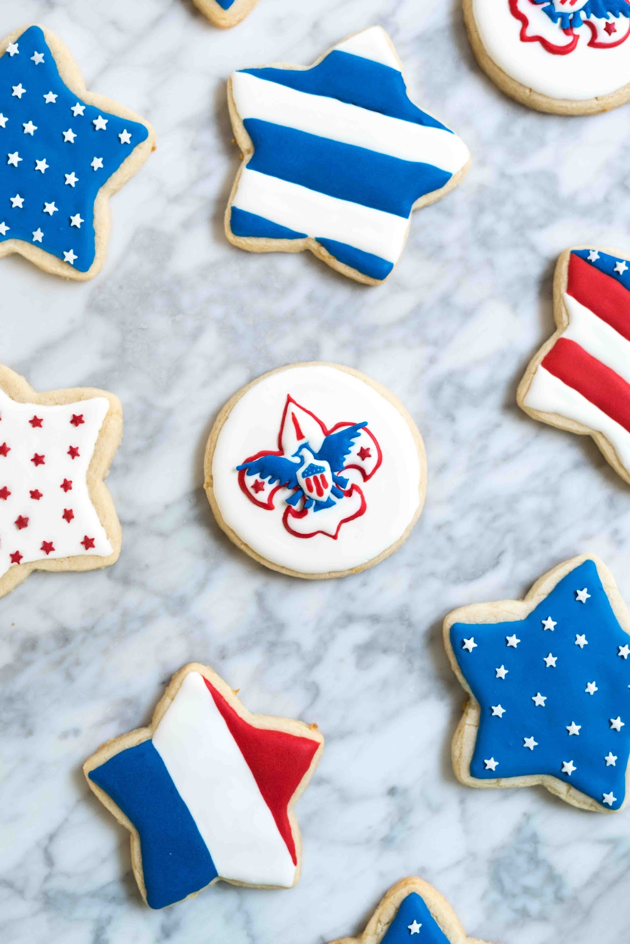 patriotic cookies, dessert, stars, cutout cookies, sugar cookies, lemon sugar cookies, best tasting sugar cookies, royal icing, tips, ideas, how to decorating sugar cookies, best royal icing, boy scout cookies, american eagle, usa, america, pretty sugar cookies, complicated, court of honor, american flag, flag cookies, 4th of july,