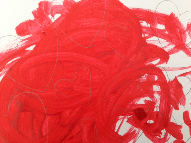 White card painted red by a child with hearts drawn on it