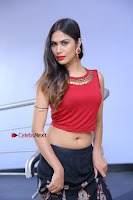 Telugu Actress Nishi Ganda Stills in Red Blouse and Black Skirt at Tik Tak Telugu Movie Audio Launch .COM 0228.JPG