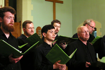Composer, Pierre Massie, sings from the tenor section with his choir, The Stairwell Carollers