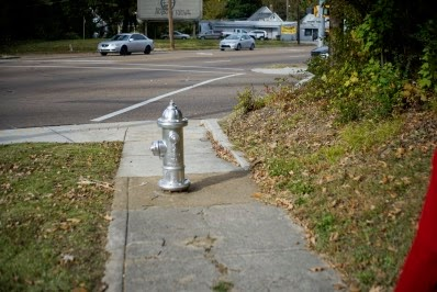 sidewalk blocked by fire hydrant