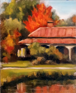 Oil painting of a Victorian-era house with a red roof reflect in a pond in the foreground.