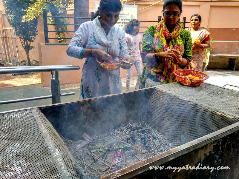 Devouts lighting incense at Shani Shinganapur Temple, Maharashtra
