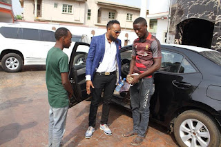 Shoe-rack hawker returns with mum after 16-months to thank singer Kcee for changing his life