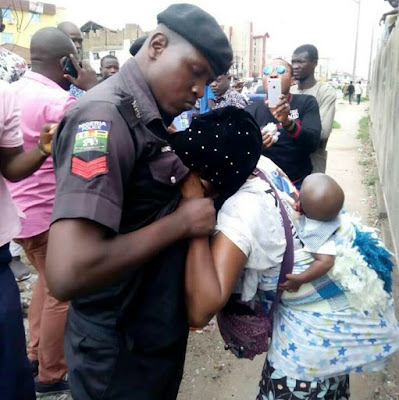 Bribe-Seeking Policeman Slaps Nursing Mother (Photos)