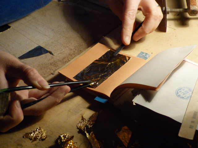 adjusting the gold foil