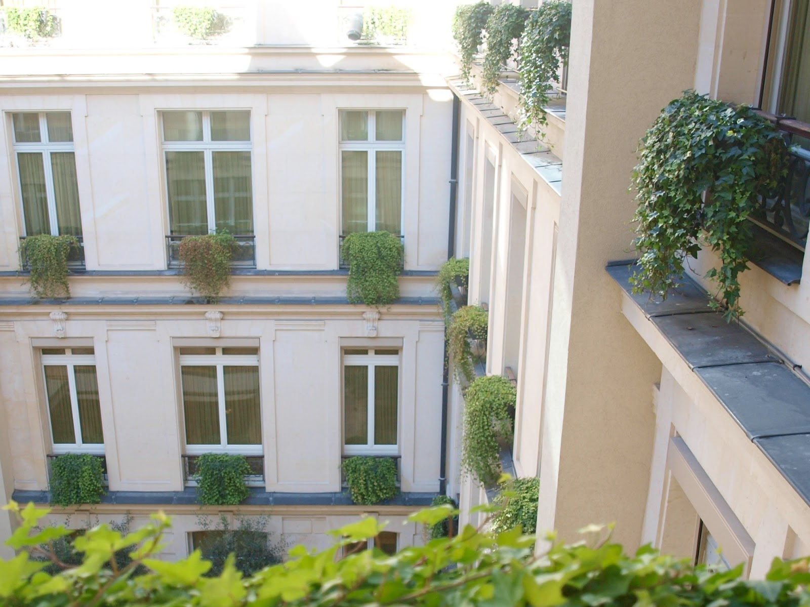 View into courtyard from suite at Park Hyatt Paris - by Hello Lovely Studio