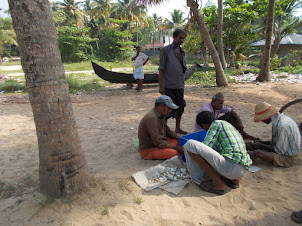 Thursday(10-3-2016) :- Locals and fish seller on Marari Beach.