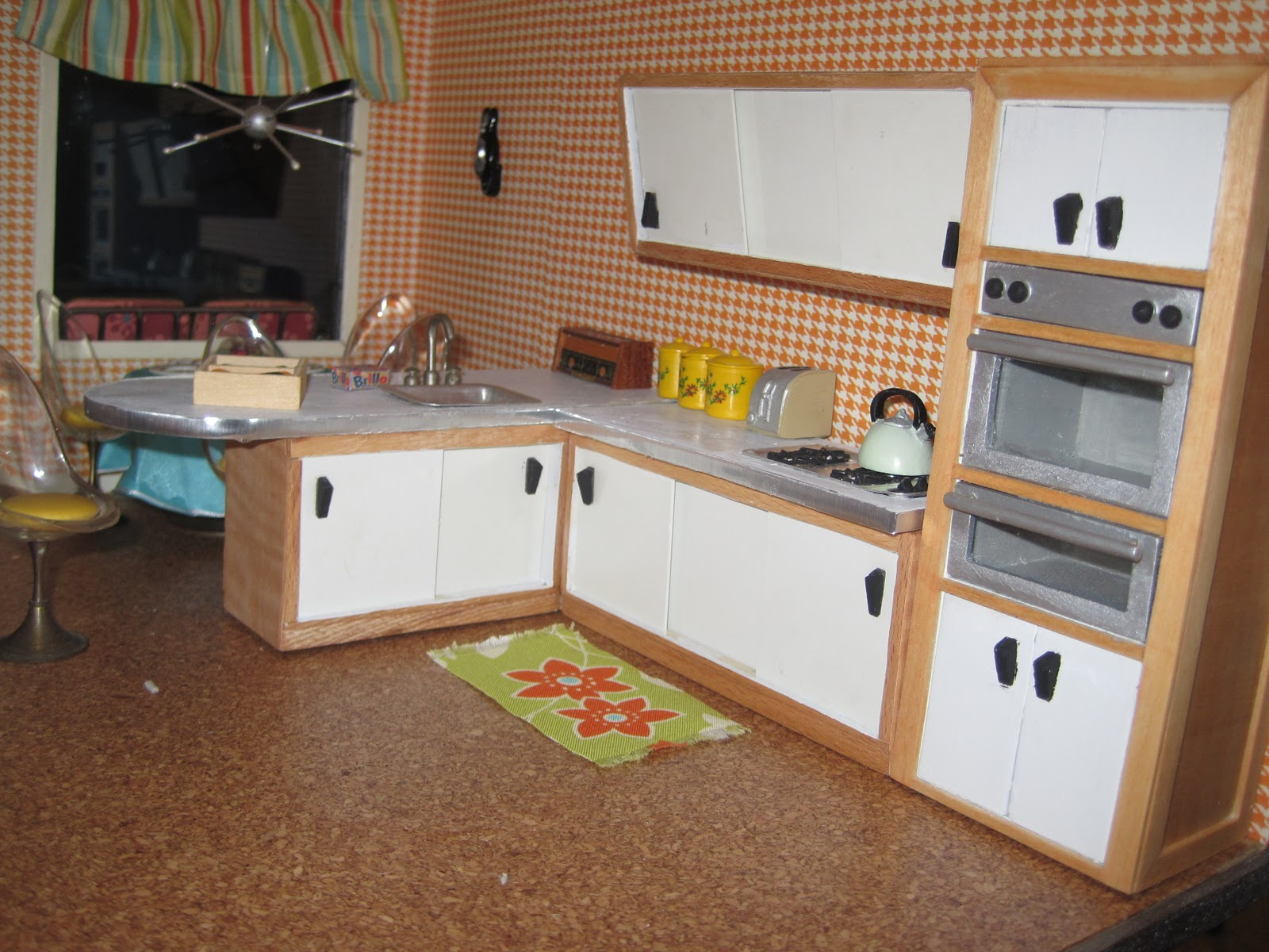 Kitchen cabinets for dollhouse - I Cut The Larger Piece Apart To Make An Upper And Lower Cabinet I Sanded Veneered And Sanded Some More To Turn The Pieces Into This