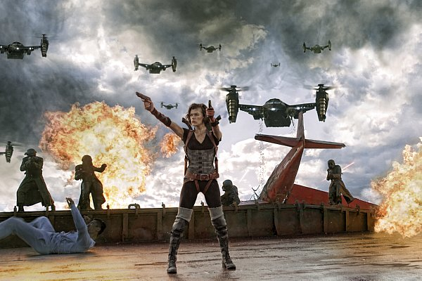 Alice shooting two guns, behnd her men dressed in black with weapons, explosions and helicopters above