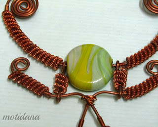 lampwork focal bead with copper , coiled wire elements