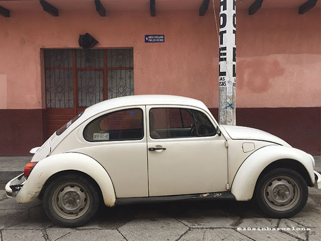 Old white  beattle car in San Cristobal de las Casas, México