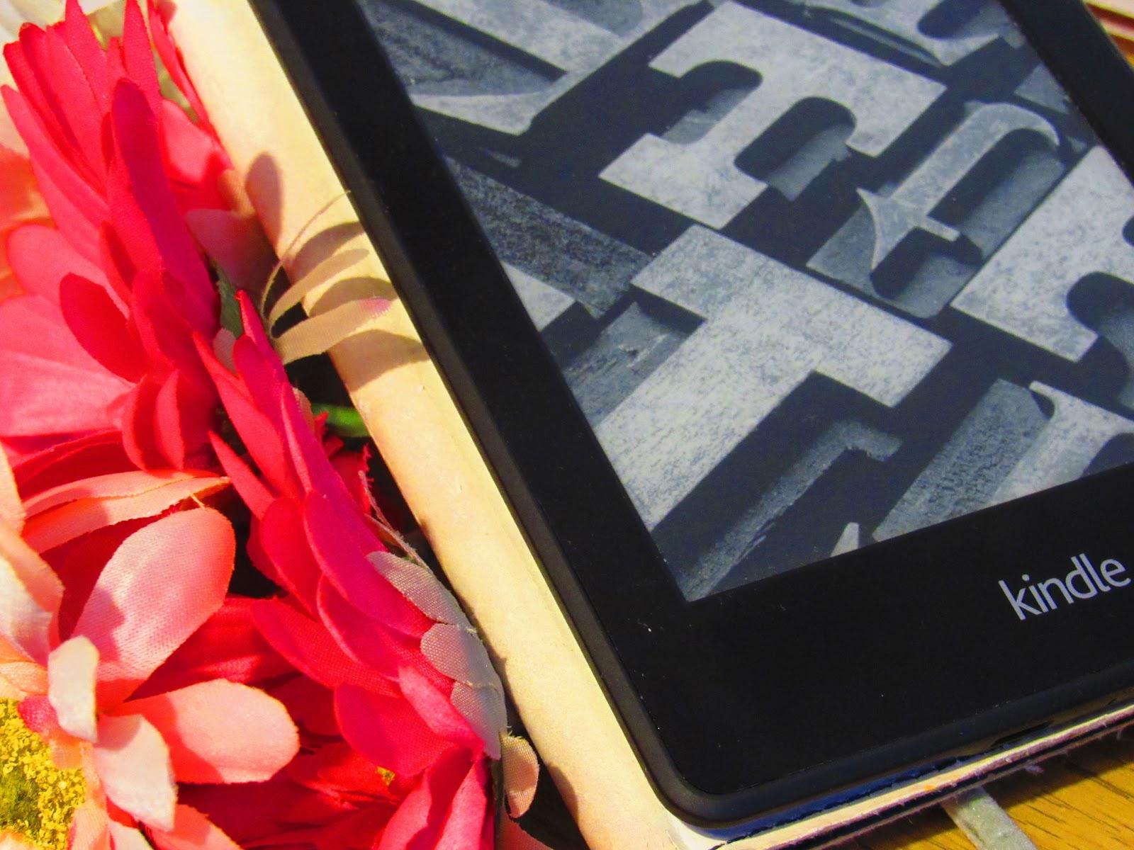 Pink floral arrangement and Kindle
