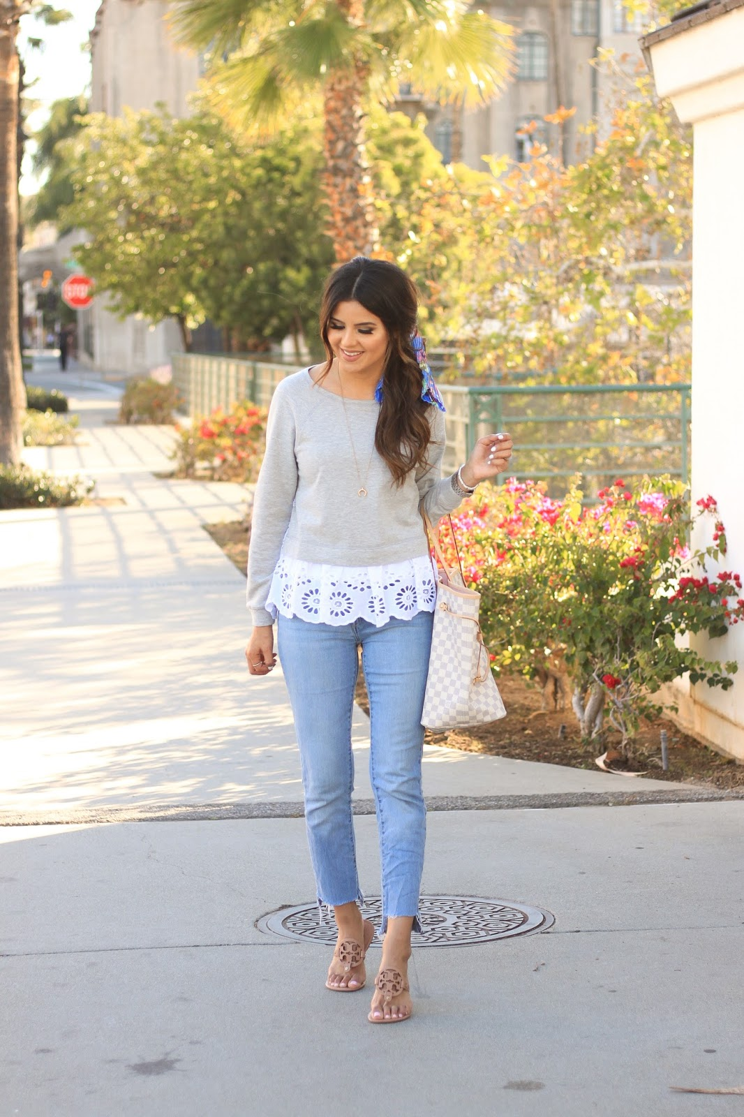 Eyelet trends for spring how to dress up a sweatshirt with tory burch miller sandals