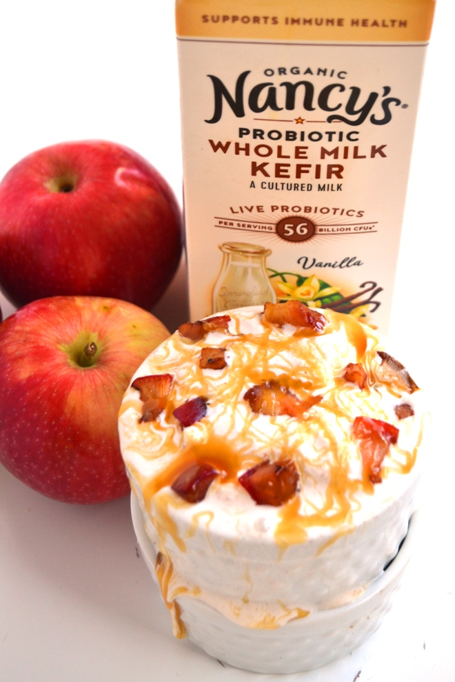 Caramel Apple Ice Cream is a healthier take on traditional ice cream and is made with Greek yogurt, kefir, sauteed cinnamon apples and a drizzle of sweet caramel! www.nutritionistreviews.com