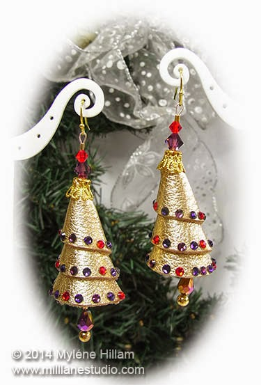 Leather Christmas Tree earrings draped with flatback crystals.