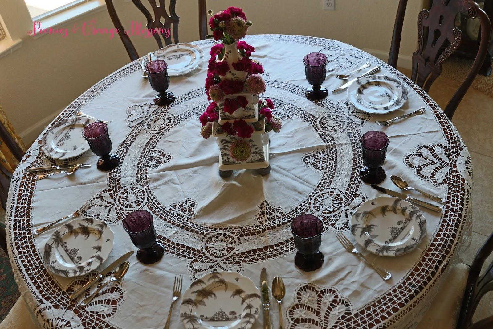 Spring Table with Juliska Tulipiere, purple carnations and ranunculus and an antique lace tablecloth